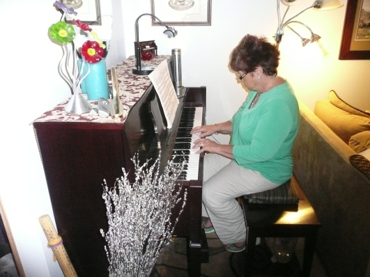 Carol Young plays the piano.